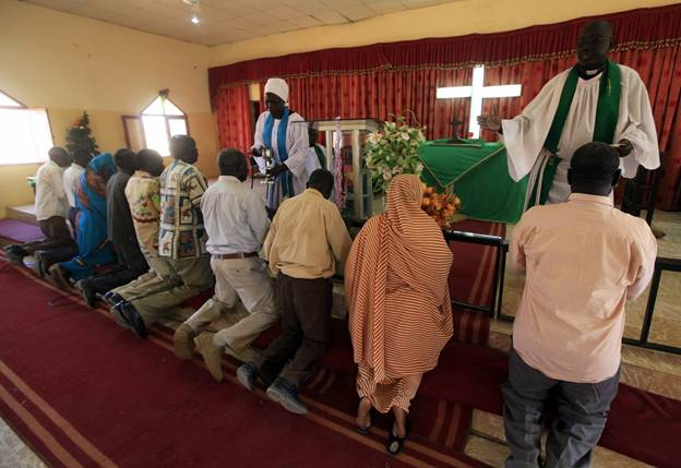 Worshippers attend Sunday prayers in Baraka Parish church, Khartoum